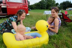 Zoe and Madi bathing the children in a giant duck!