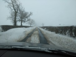 Note the Five Foot Drifts by the side of the road