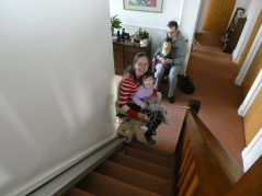 MeiYan taking a ride on my stair lift in my in-laws house