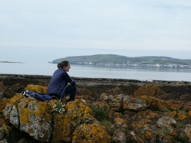 Gazing over rocks at Port St Mary