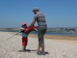 Luca flying a kite at Chisel Beach...