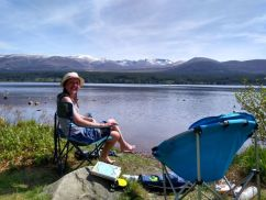 Snow capped mountains at Loch Morlich