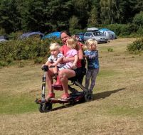 Three kids on a scooter!