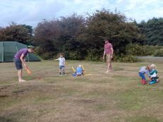 Trying to teach the kids to play cricket!